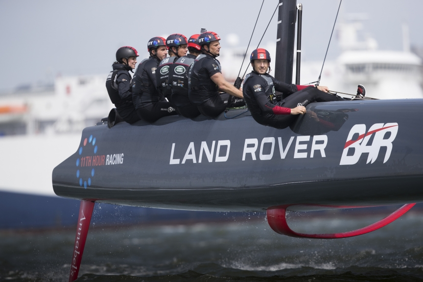 Flying on T1. Maybe the team was training on T1 to get ready for the AC World Series in Chicago - it is close to the configuration of an AC45, with tiller steering, crew sitting on the hull and no grinding pedestals. All photos in this article by Lloyd Images.